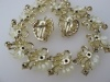 Incredible STAR 1950s plastic and rhinestone flower necklace earring set