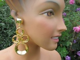 Huge 1980s gold hoop earrings 4 1/2 inches clip