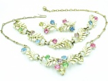 Vintage 1950s cream enamel pastel rhinestone jewelry set by Jewelcraft